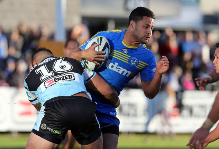 Jarryd Hayne being tackled by a Sharks player