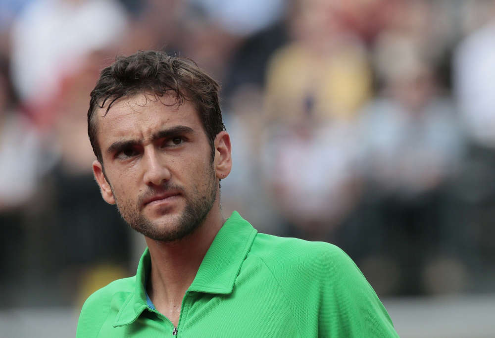 Marin Cilic will take on American John Isner in the third round at Wimbledon
