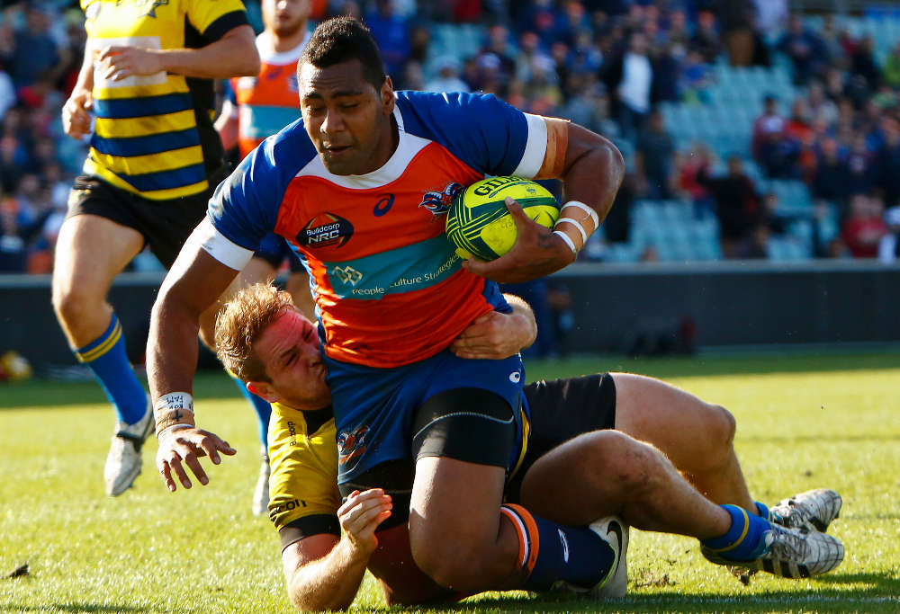 Rams winger Taqele Naiyaravaro is tackled