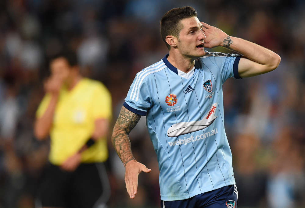 Sydney FC's Corey Gameiro listens to a raucous crowd at Allianz Stadium