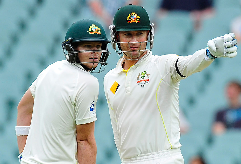 Australian batsmen Michael Clarke (R) and Steve Smith