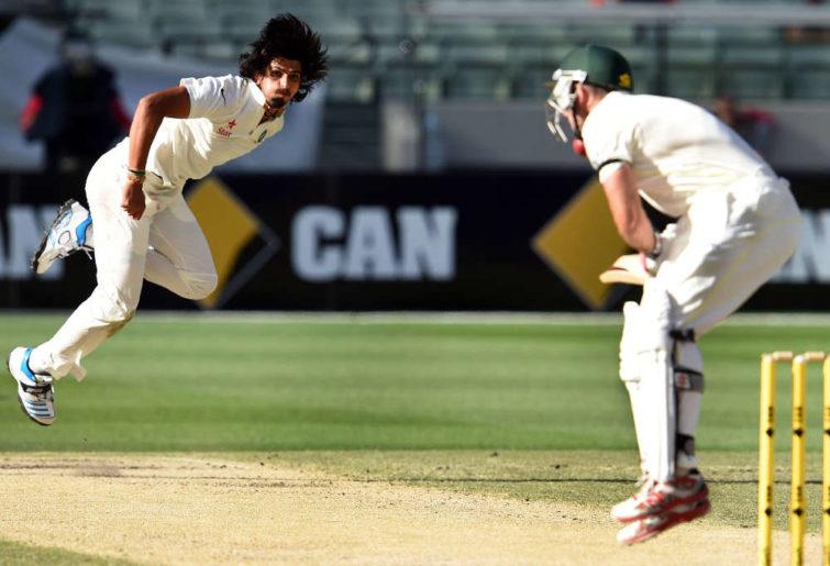 Ishant Sharma (L) hits Australia's batsman Shaun Marsh