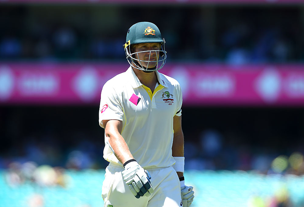 Shane Watson of Australia walks from the field after being caught out