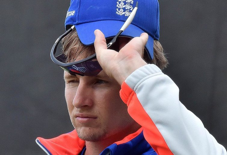 England's player Joe Root adjusts his shades and cap during a training session at Adelaide Oval on March 8, 2015. AFP PHOTO / Saeed KHAN --