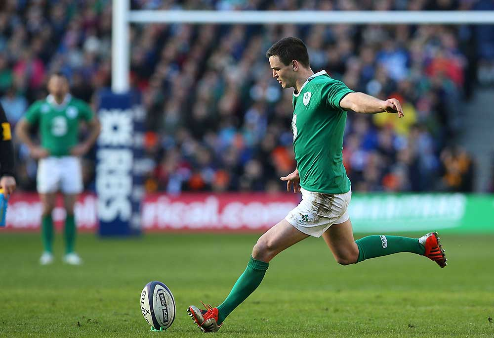 Ireland's fly half Jonny Sexton kicks a penalty