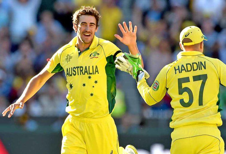 Mitchell Starc of Australia celebrates with Brad Haddin