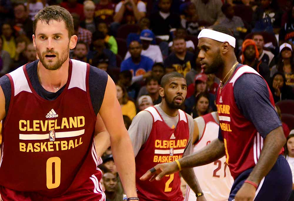 Kevin Love, Kyrie Irving, and LeBron James of the Cleveland Cavaliers