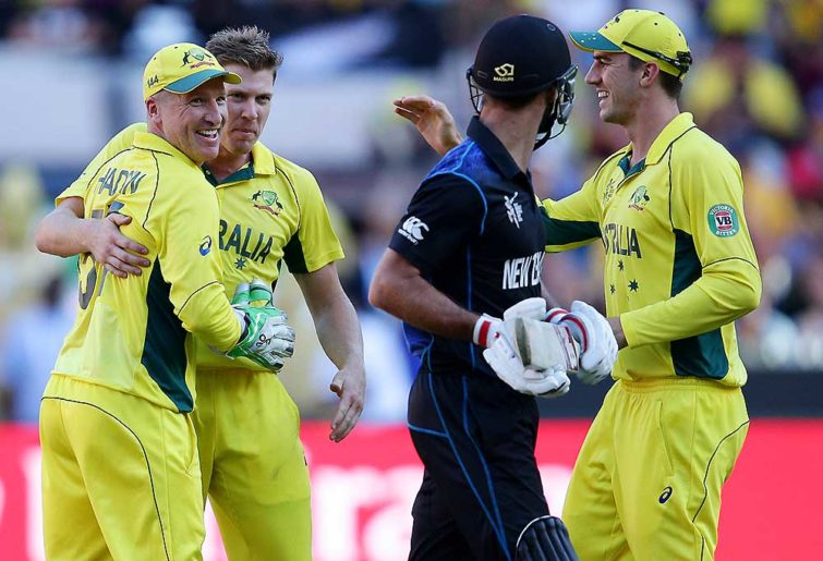 New Zealand's Grant Elliott chats with Australian players Brad Haddin, left, and James Faulkner as Pat Cummins, right, celebrate