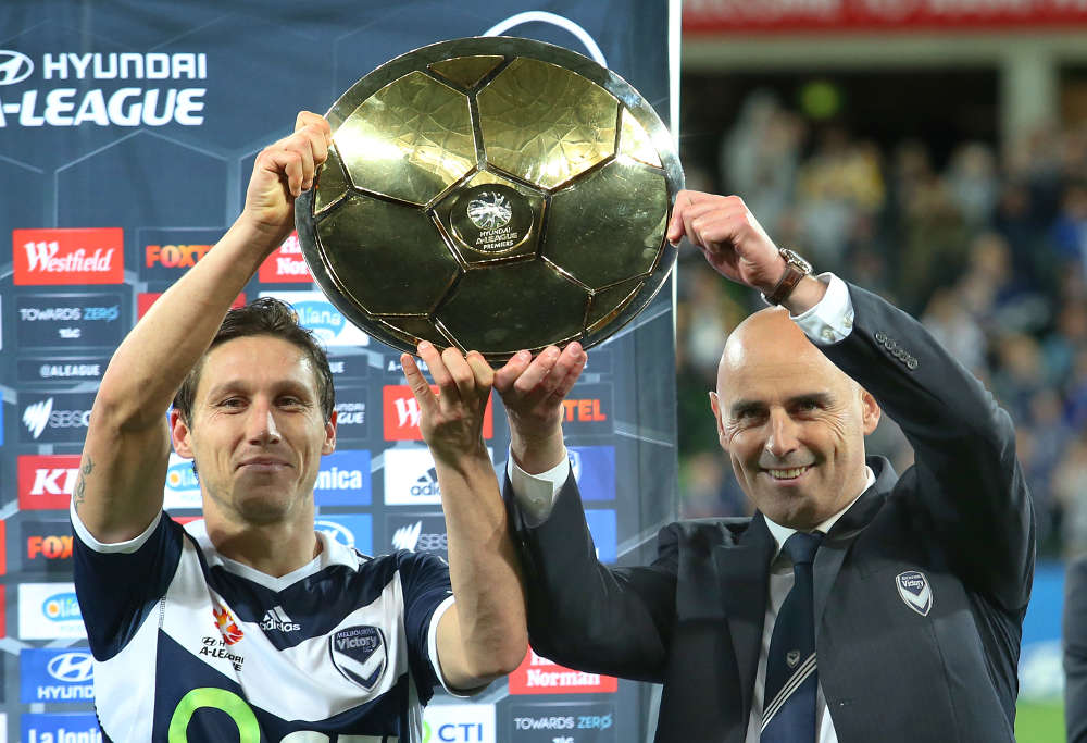 Kevin Muscat and Mark Milligan holding up Melbourne Victory Premier's Plate