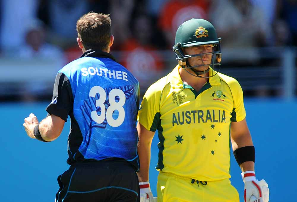 Australian batsman Aaron Finch walks after he is bowled by New Zealand's Tim Southee