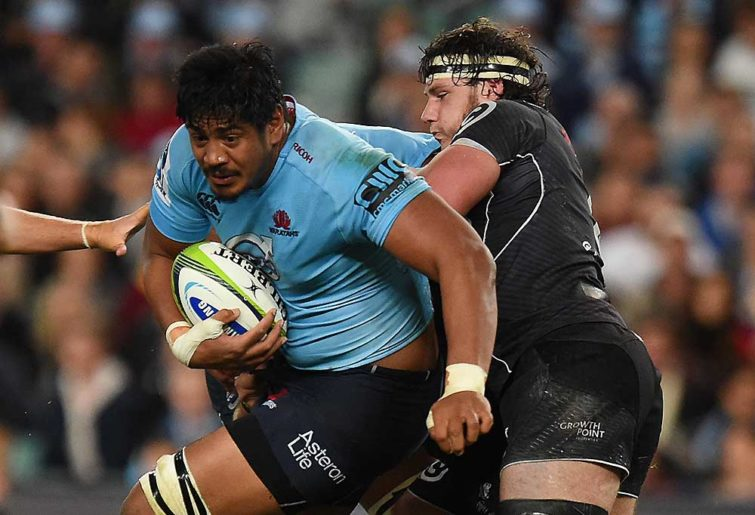 Will Skelton of the Waratahs is tackled by Marcell Coetzee of the Sharks