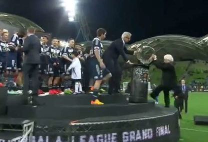 Frank Lowy falls off the stage during A-League Grand Final