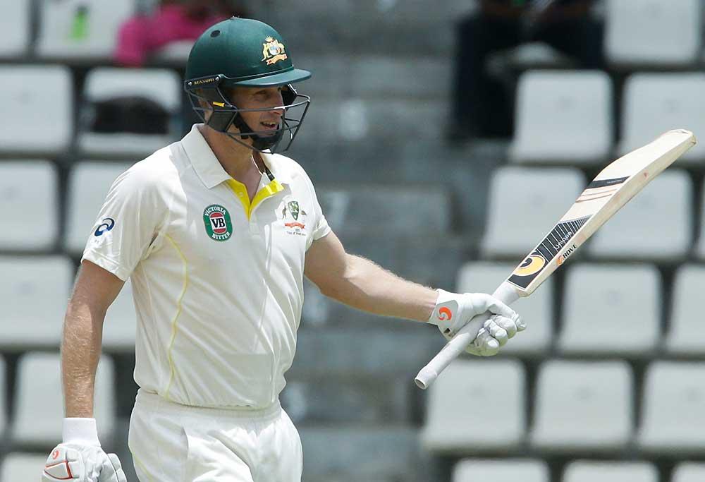 Australias Adam Voges raises his bat