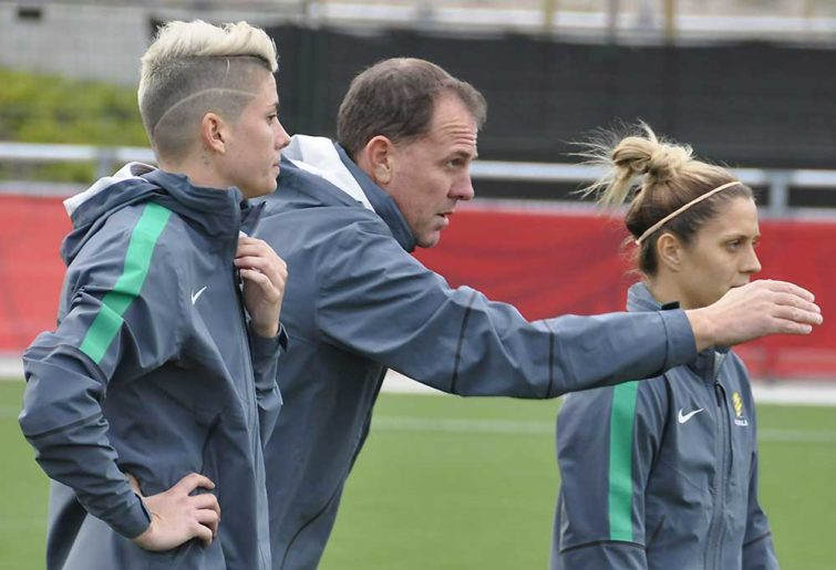 Matildas coach Alen Stajcic directs two of his players