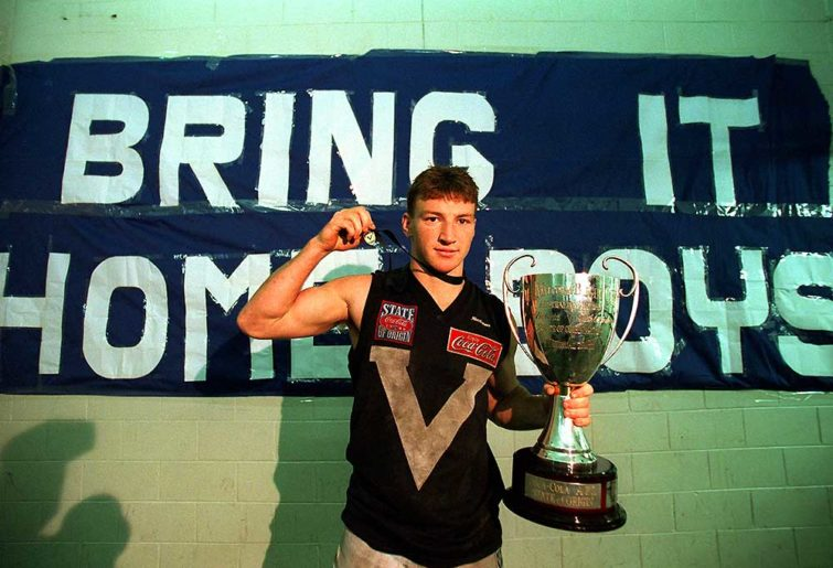 Brent Harvey for Victoria in the rooms with the trophy and the E.J Whitten Medal