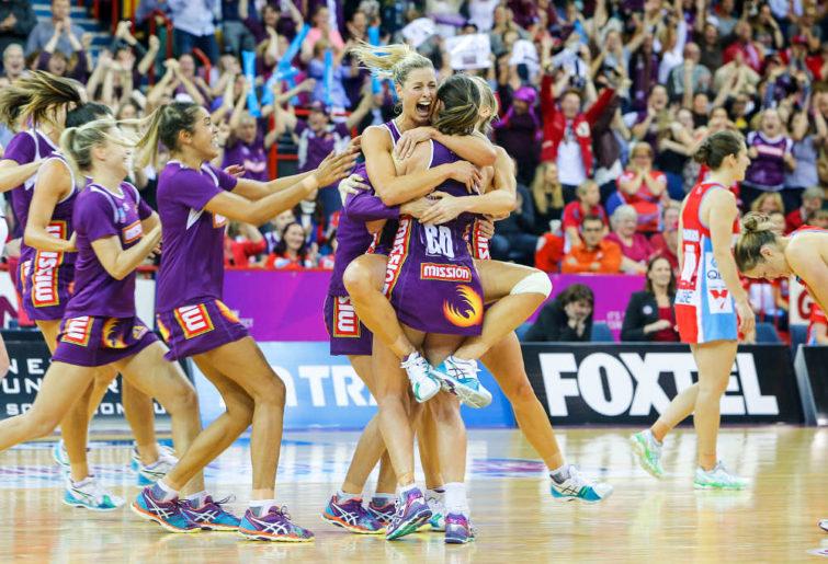 The Queensland Firebirds celebrate after winning the Netball grand final