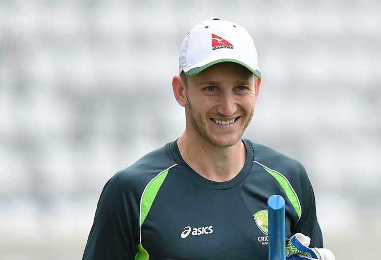 Australia's wicketkeeper Peter Nevill arrives for training