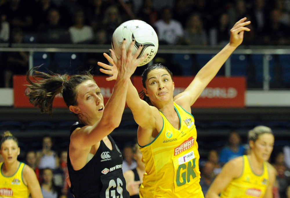 New Zealand's Bailey Mes, left and Australia's Sharni Layton contest the ball