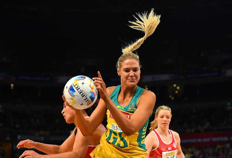 Caitlin Bassett of Australia competes for the ball with Lateisha Kidner of Wales