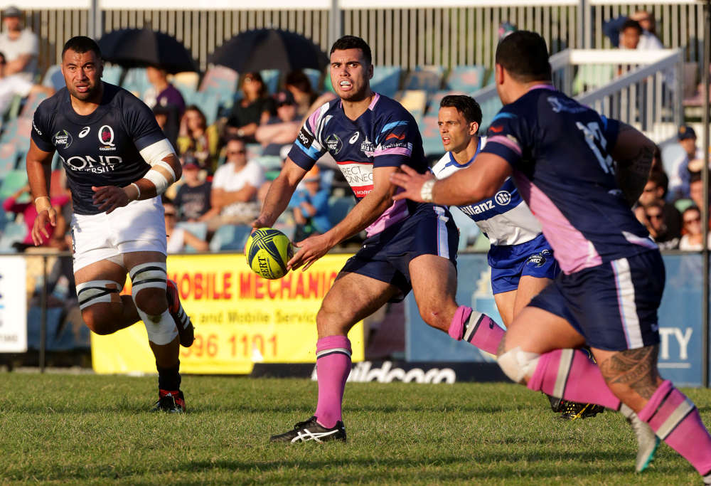 Melbourne Rising flyhalf Jack Debreczeni takes on the Queensland Country defence