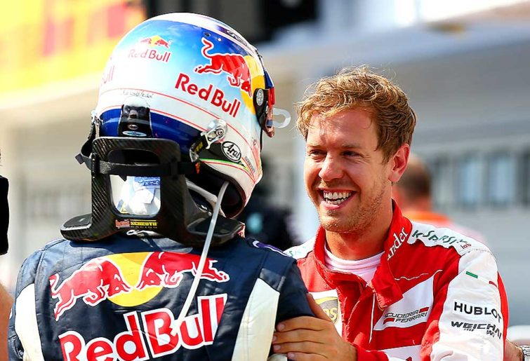 Sebastian Vettel of Germany and Ferrari speaks with Daniel Ricciardo of Australia and Infiniti Red Bull Racing