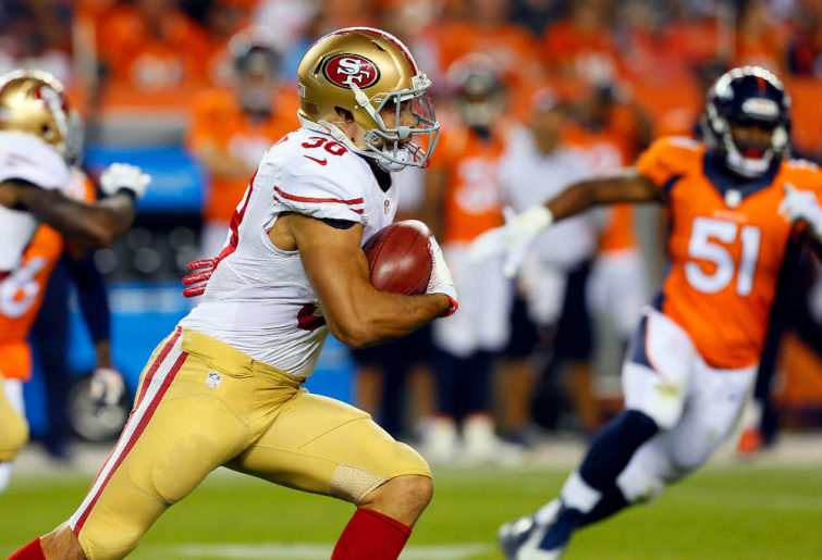Jarryd Hayne returns a punt for the San Francisco 49ers