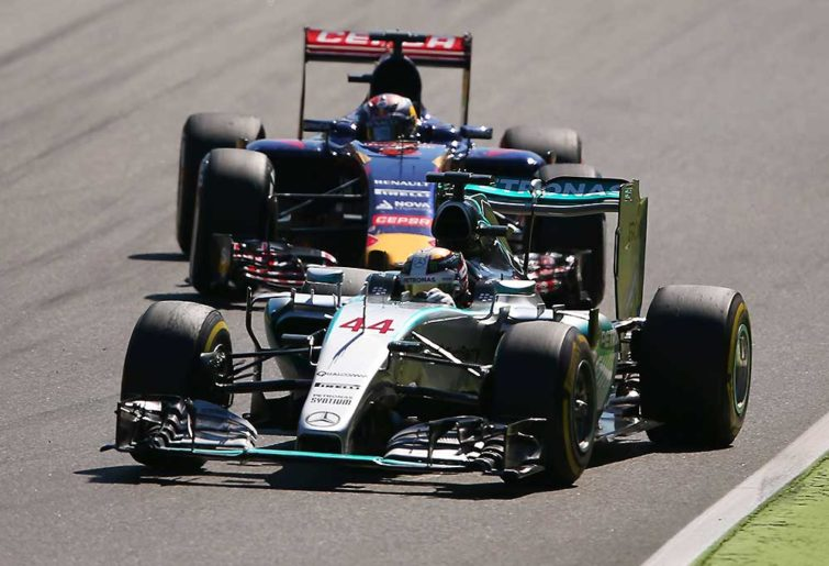 Lewis Hamilton of Great Britain and Mercedes GP laps Max Verstappen of Netherlands and Scuderia Toro Rosso