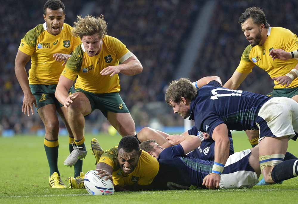 Australia's Tevita Kuridrani (C bottom) reaches out to score a try against Scotland in the second half of his team's 35-34 victory in the Rugby World Cup quarterfinals on Oct. 18, 2015 at Twickenham Stadium near London. (Kyodo) ==Kyodo
