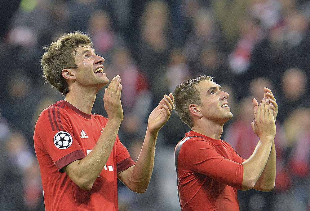 Bayern's Thomas Mueller, left, and Bayern's Philipp Lahm