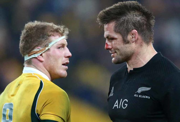 New Zealand's Richie McCaw walks past Australia's David Pocock