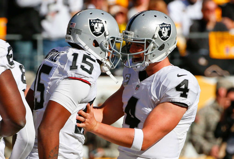 Oakland Raiders' Michael Crabtree and Derek Carr