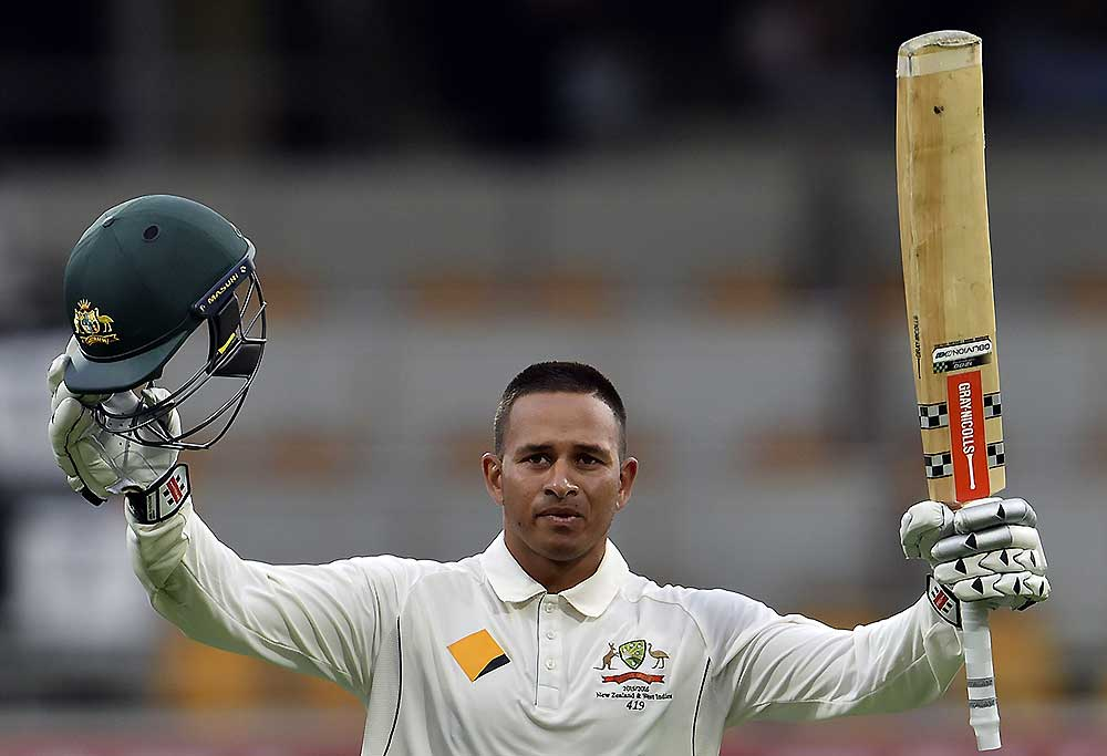 Australia's batsman Usman Khawaja celebrates his first Test century