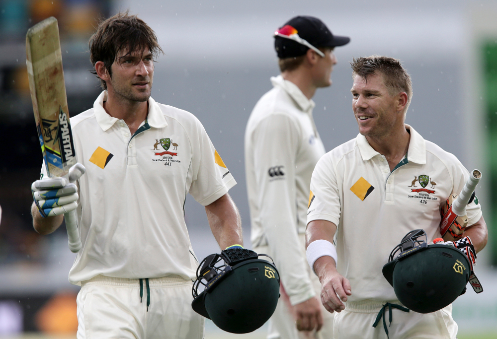 Australia's Joe Burns, left, and David Warner, right
