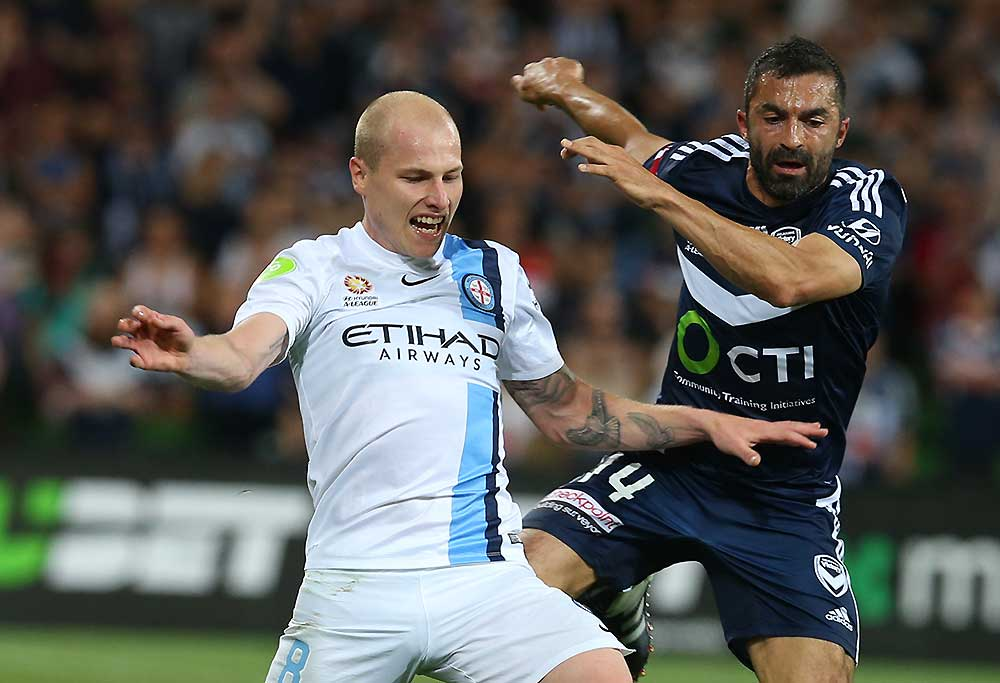 Citys Aaron Mooy (left) is tackled by Victorys Fahid Ben Khalfallah