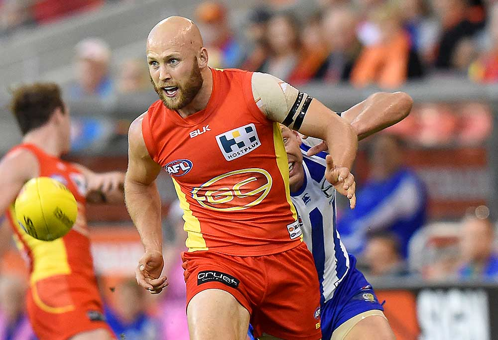 Suns player Gary Ablett takes on Kangaroos