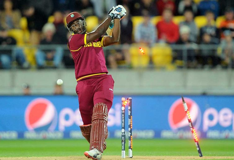 West Indies batsman Andre Russell is bowled out