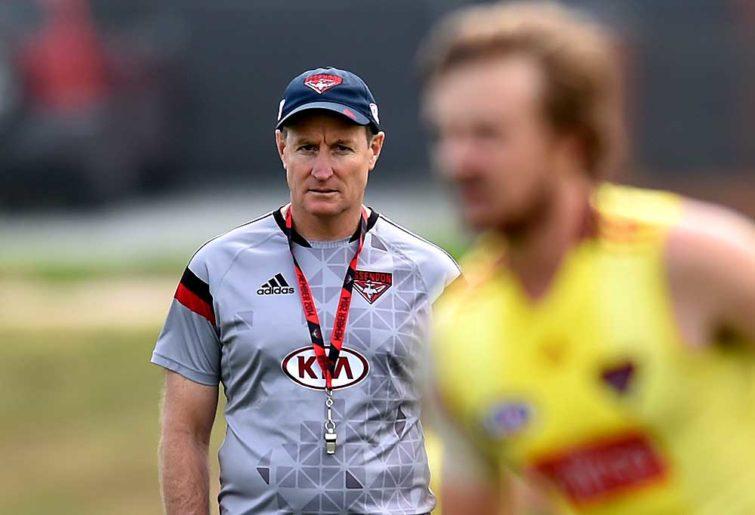 Essendon coach John Worsfold watches players train