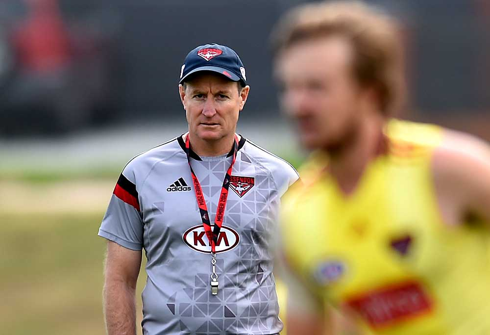 Essendon coach John Worsfold watches players train