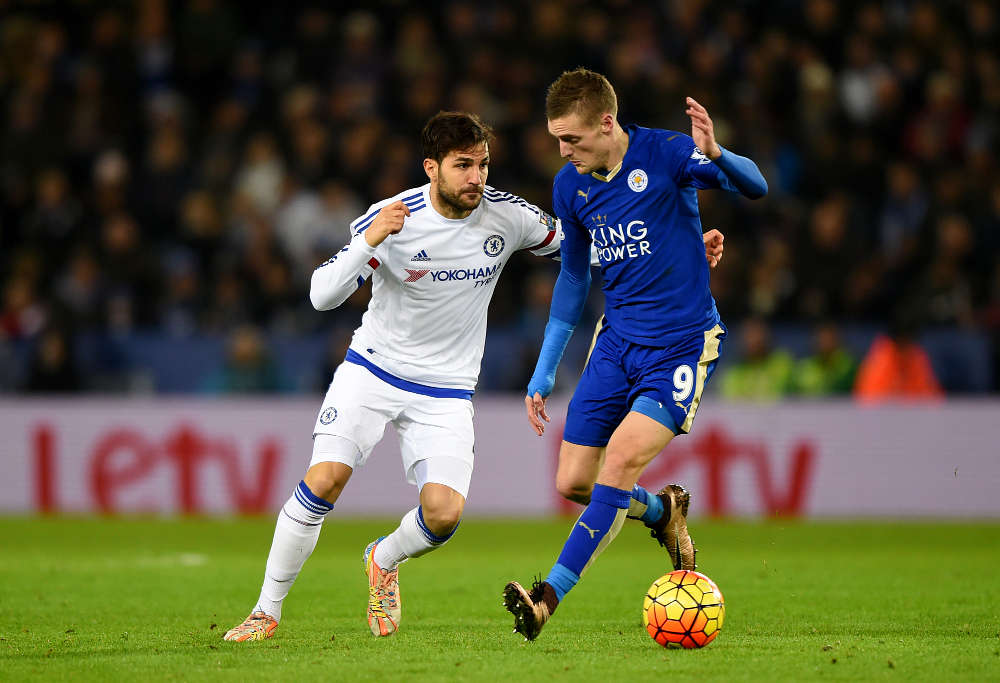 Chelsea's Cesc Fabregas and Leicester's Jamie Vardy battle for the ball