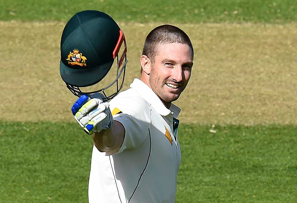 Australian batsman Shaun Marsh reacts after scoring a century