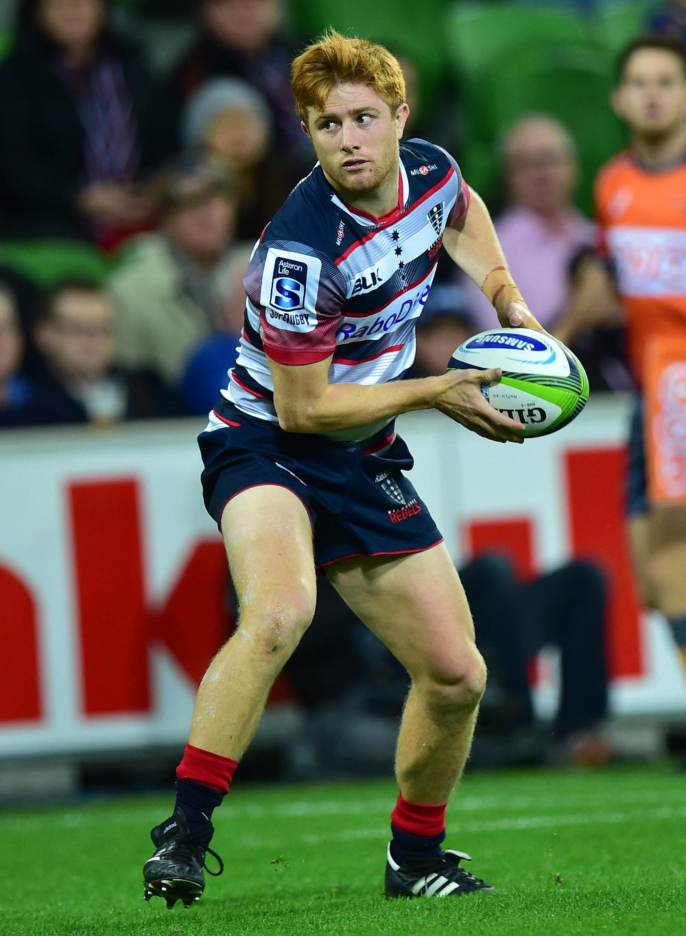 Melbourne Rebels player Nick Stirzaker passes the ball