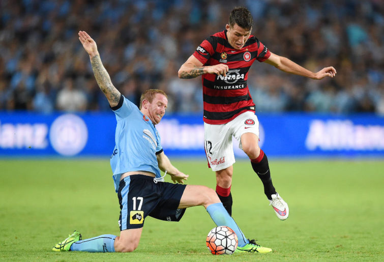 David Carney tussles with Scott Neville during the Sydney Derby.