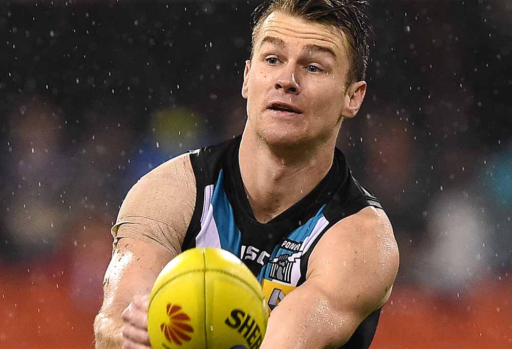 Robbie Gray dishes off a handball