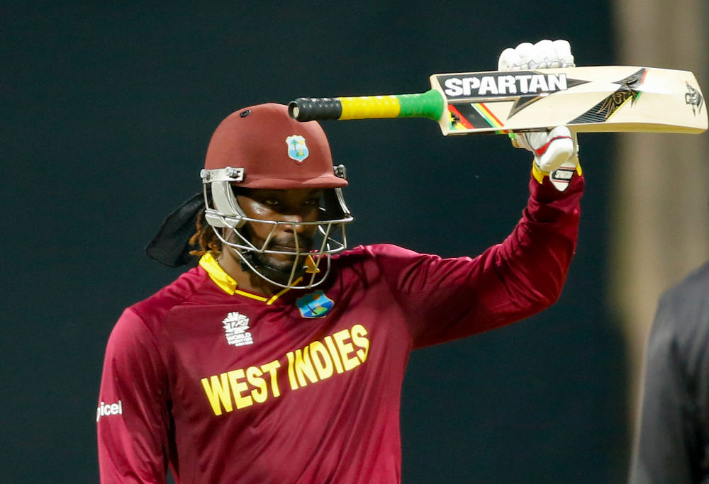 West Indies' Chris Gayle raises his bat