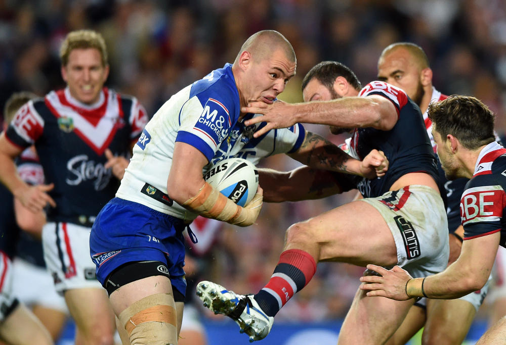David Klemmer of the Bulldogs is tackled by Boyd Cordner