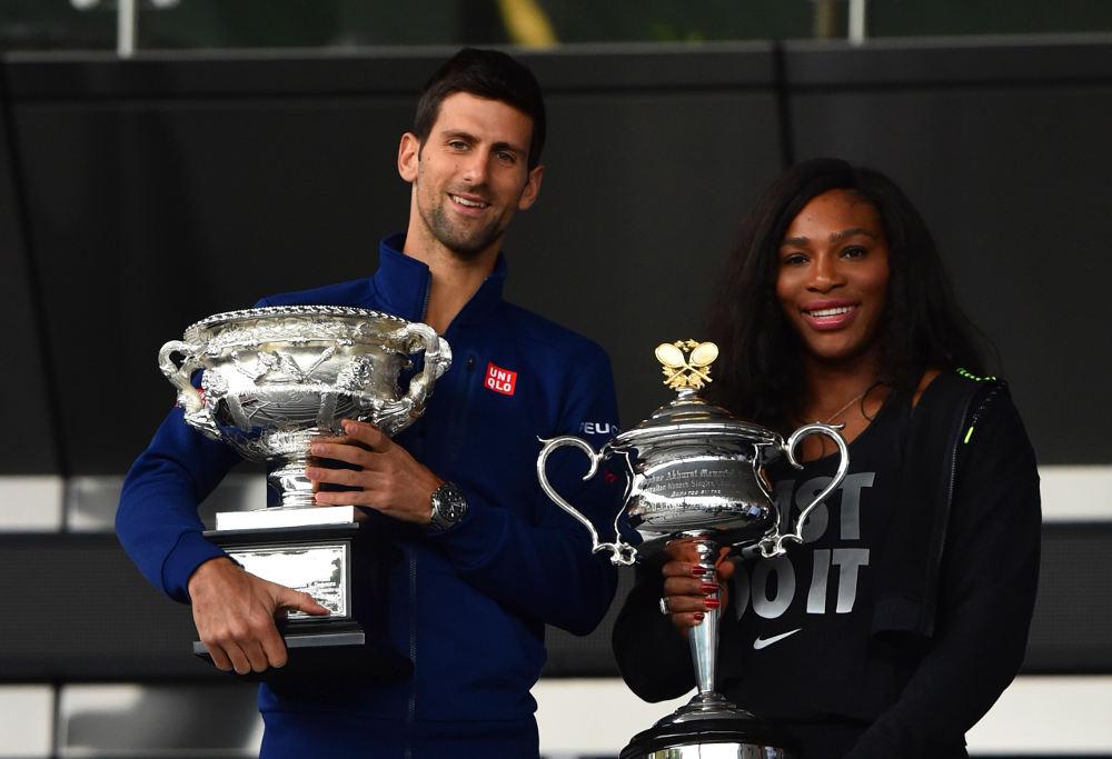 Novak Djokovic and Serena Williams pose with trophies