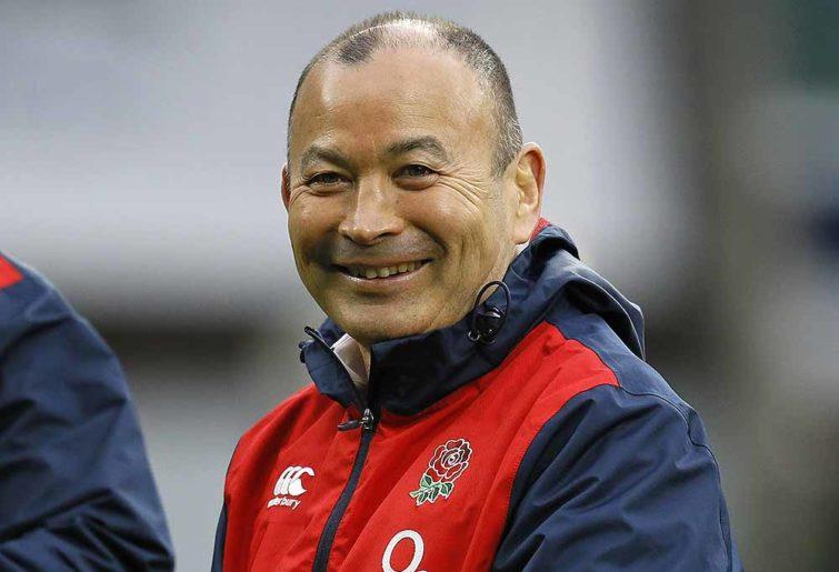 Eddie Jones smiles and is happy