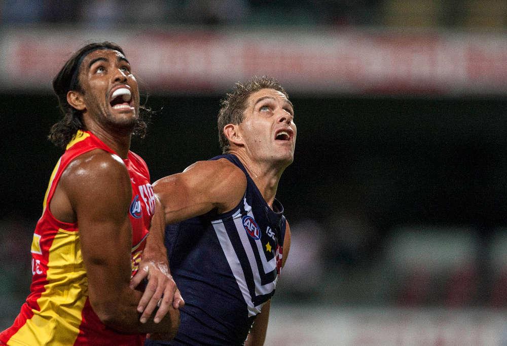 Aaron Sandilands and Tom Nicholls battle for AFL ball