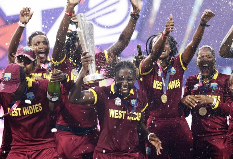 West Indies' cricketers celebrate with the trophy