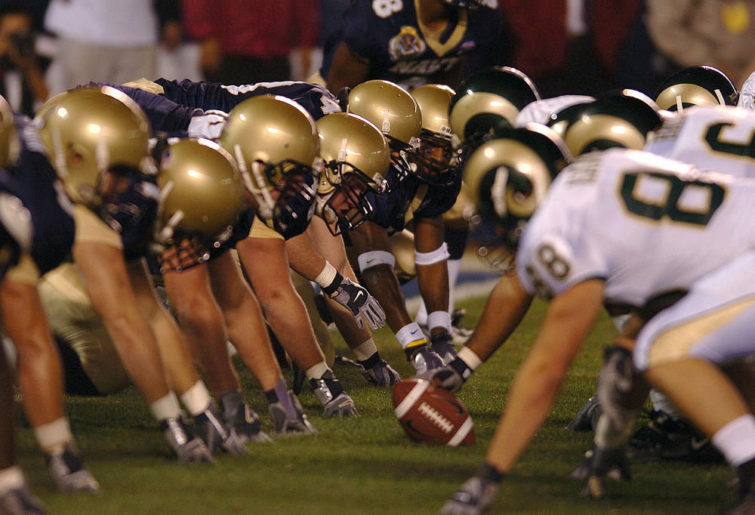 American Football players line up Canadian football. CFL. Image: Wikicommons generic
